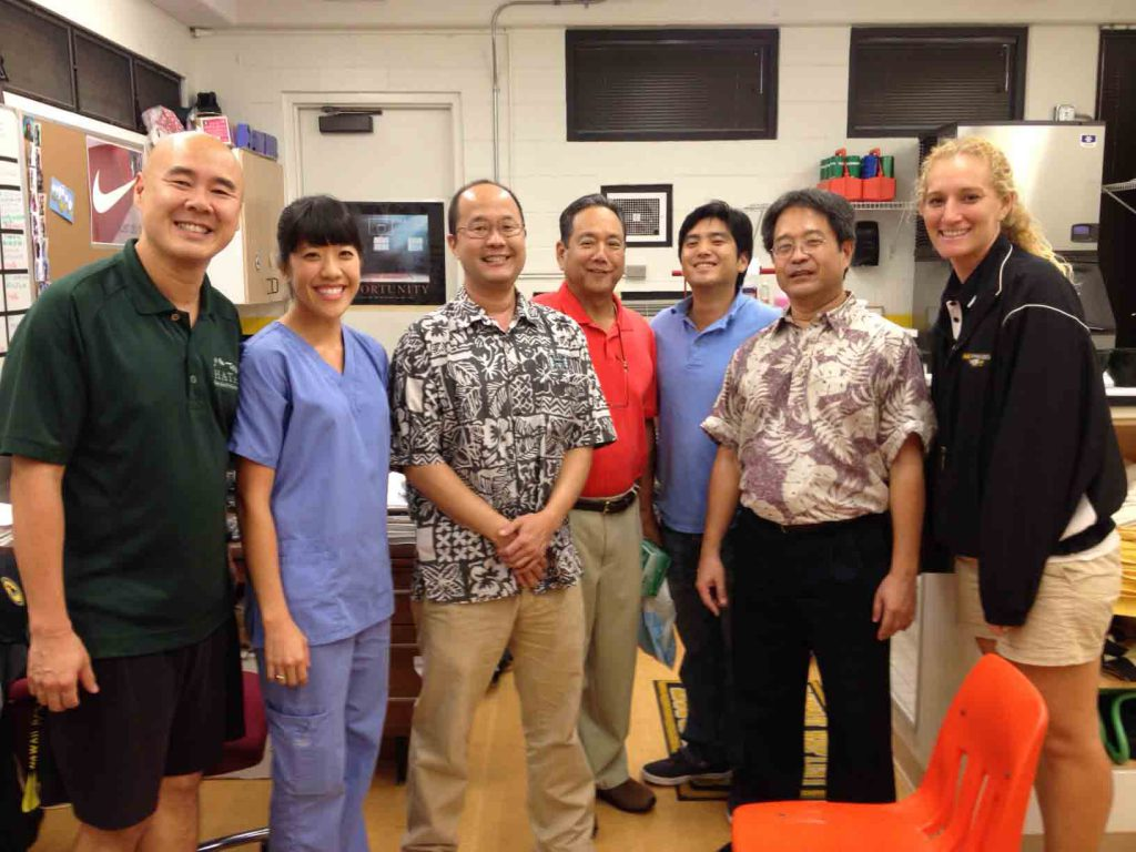 From left to right: Sam Lee, HBA Athletic Trainer; Elise Chong, dental student; Dr. Steve Kumasaka; Dr. Dean Sueda; Stephen Sueda ('04), dental residency student; Dr. Dwayne Sakata; and Shannon Keen, HBA Athletic Trainer. Photo by Deren Oshiro.